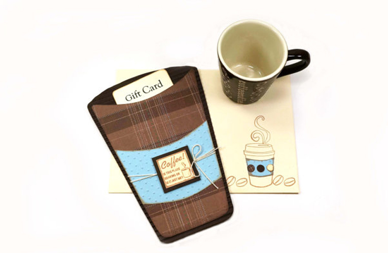 coffee cup holds gift card