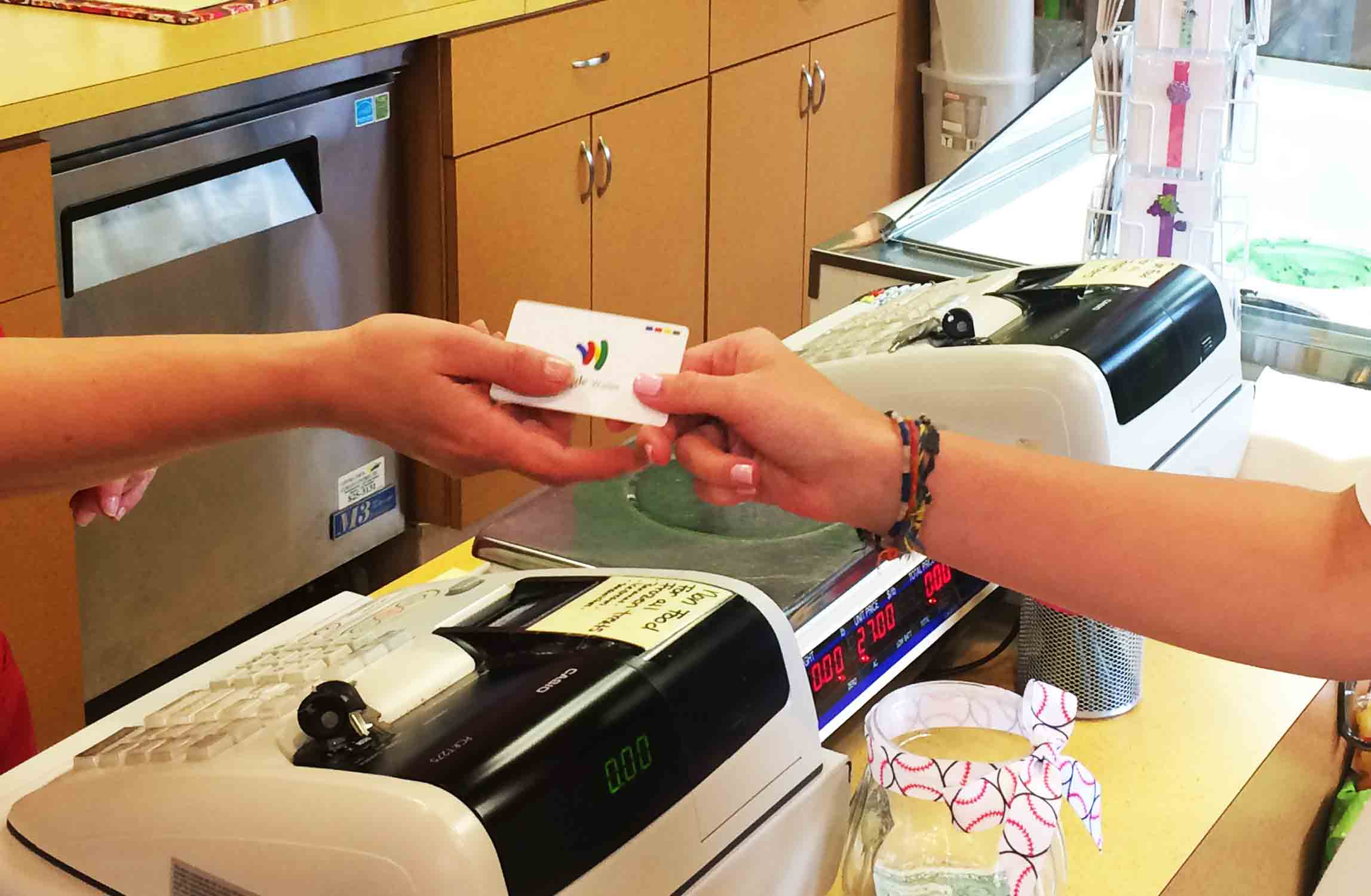 Handing Google Wallet card to cashier