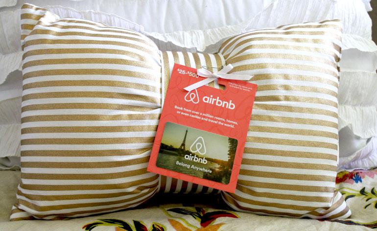 Airbnb gift card on a bed and breakfast pillow