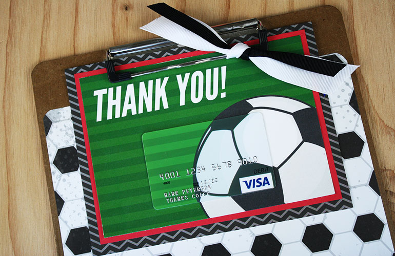 Visa<sup>&reg;</sup> gift card on clipboard for coach