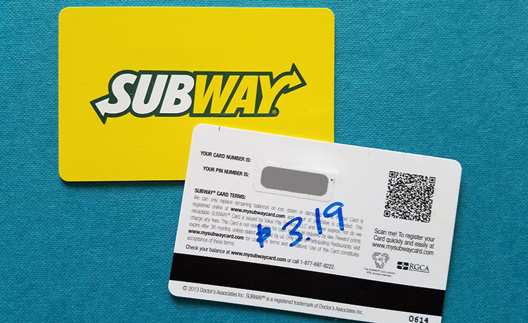 Subway gift card with $3.19 written on it