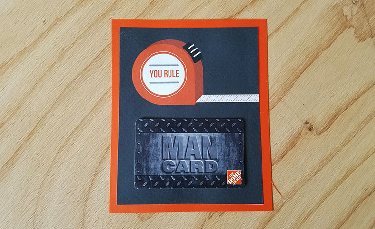 The Home Depot Man Card on holder