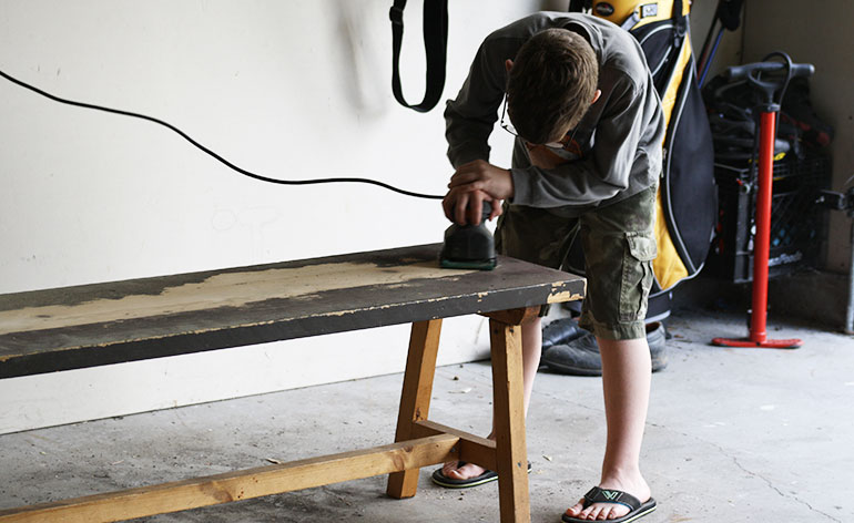 boy working on furniture