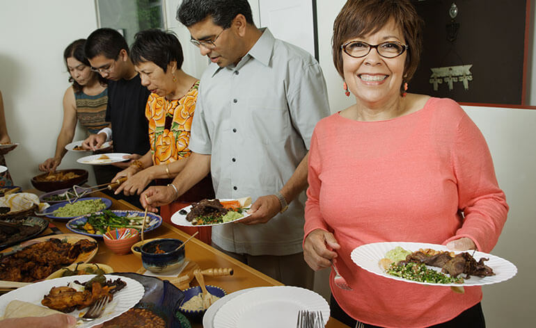 woman gathered with family for dinner
