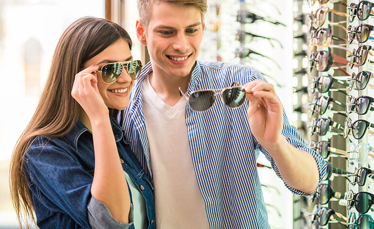 Couple shopping for sunglasses