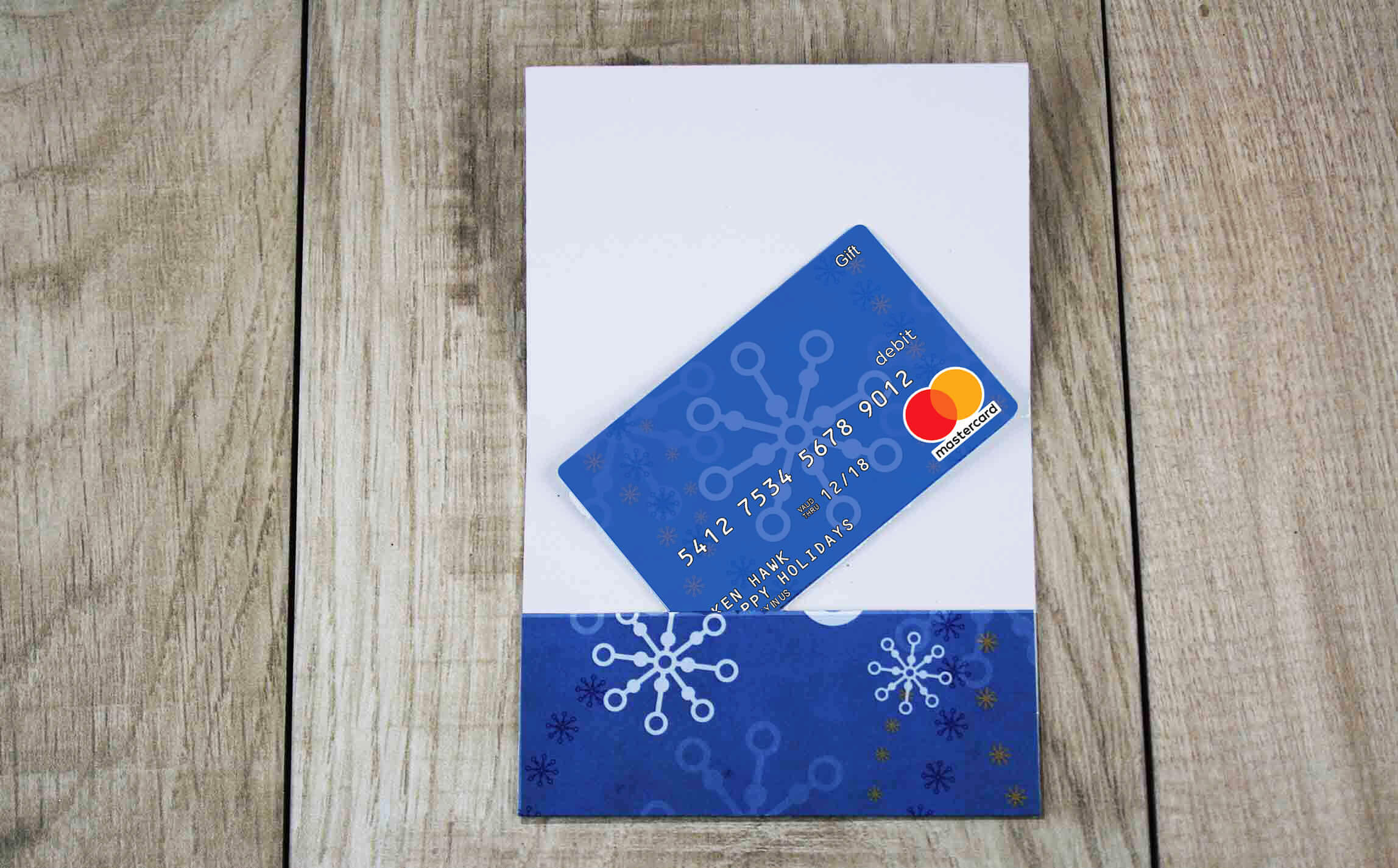 put gift card into envelope