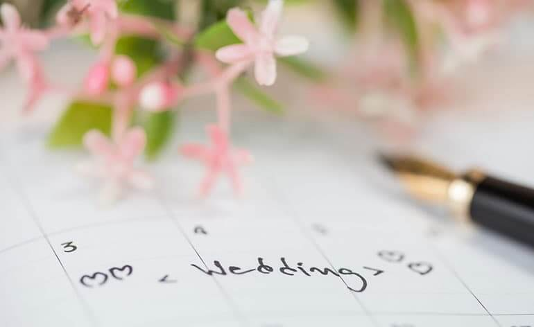 wedding date written on a calendar