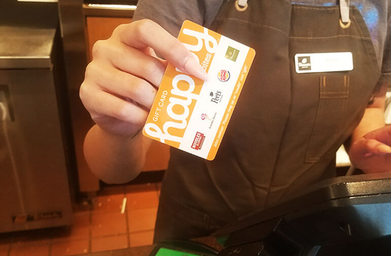 Cashier holding Happy Card