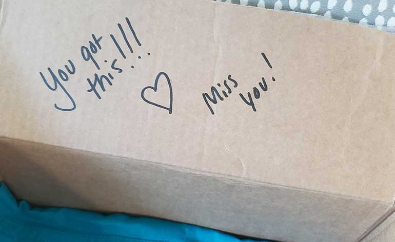 handwritten notes in packing boxes