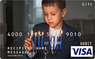 little boy lighting menorah