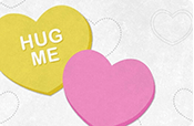 A yellow heart with text that says 'Hug me' along with a pink heart.