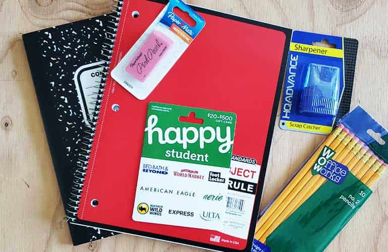 back to school supplies with happy student gift card